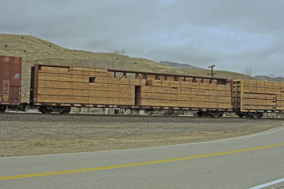 Centerbeam flatcar NOKL734407 loaded with lumber, passing through Caliente CA on the 15th Feb 2012 - Mel Rogers image used with permission