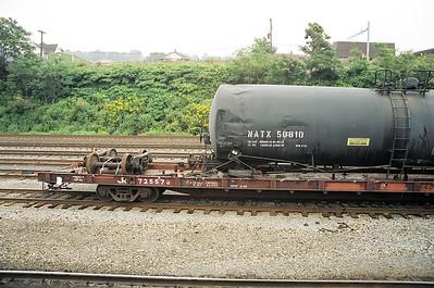 Wrecked tank car NATX50810 rides Conrail flatcar CR725576 at Conway Yard, PA - September 2000