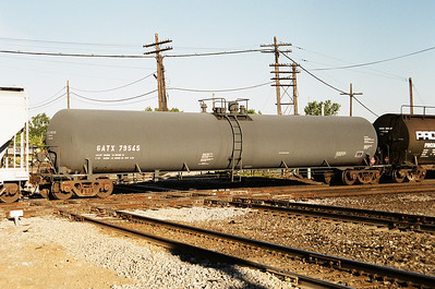Tank car GATX79545 on a southbound NS train hammers the CSX diamond at Marion Ohio in September 2000
