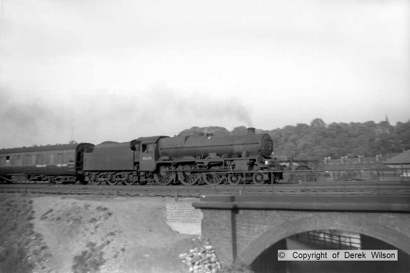 b001  LMS Jubilee 4-6-0 no. 45658 Keyes is seen at Chesterfield with a southbound express, taken from a footbridge over the old GCR line..circa 1959