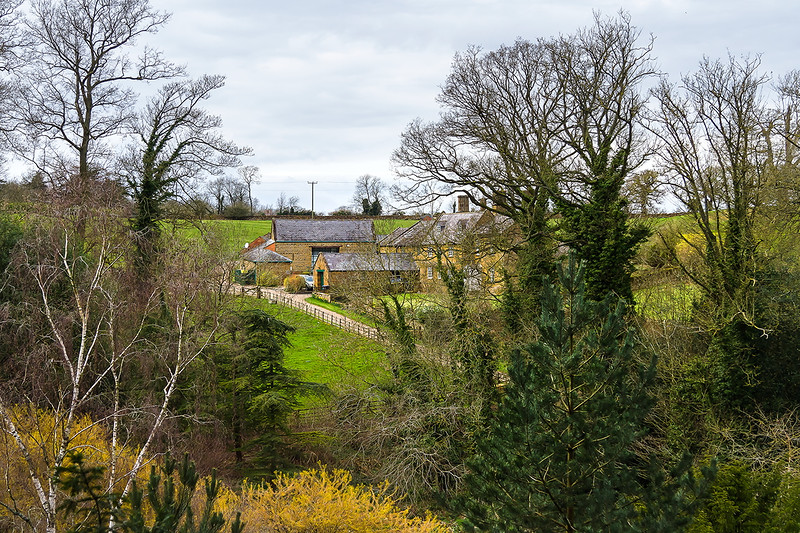 8th Apr 2016:  Home Farm from the garden of the National Trust proprty ' Upton House' in Warwickshire