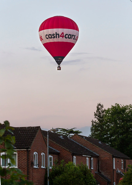 7th May 2017:  The 'cash4cars'  balloon flies low over westbury at 8.40pm on a  beautiful May evening