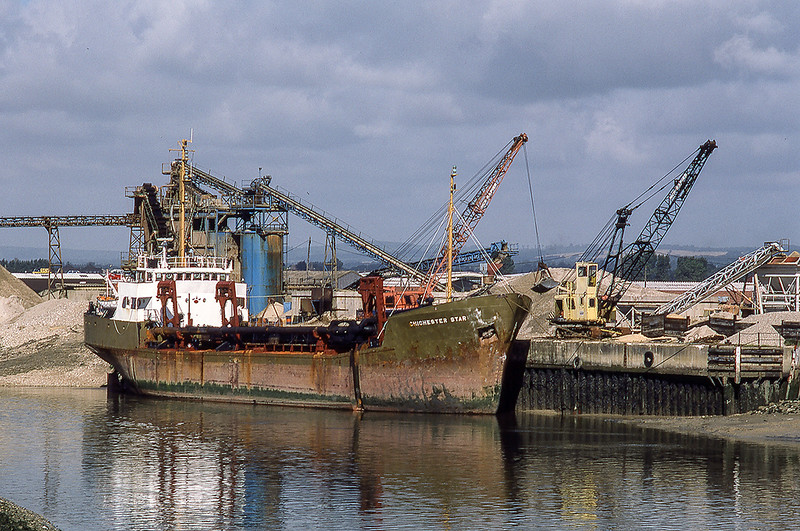 22nd Aug 1985:  The 1973 built suction dredger owned by Francis Concrete named 'Chichester Star' is unloading in Chichester Harbour.  In 1990 it was sold to Tarmac and named 'City of Portsmouth'.  Ten yeards later it was sold to a company based in Greece.