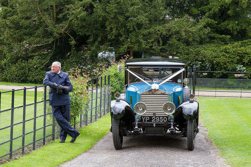 31st May 14:  The driver and the 1926 Rolls Royce wait for the married couple to emerge from the sevcice in Boulton Abbey