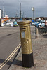 14th Sep 12:  One of Royal Mail's oldest  boxes and the first to be painted gold, in honour  of rower Helen Glover winning an Gold Olympic Medal, stands outside The Dock pub in Penzance