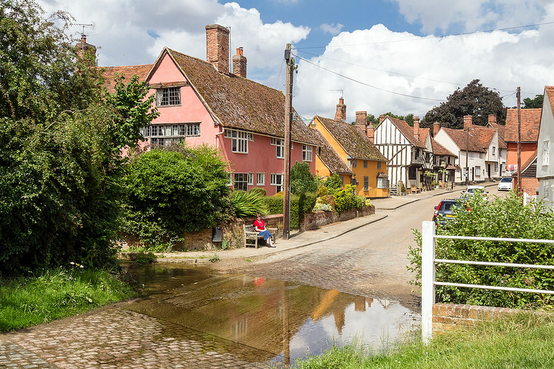 17th Jul 14:  Joy enjoying the tranquility of Kersey,  The timber framed building is a  pub built in 1600