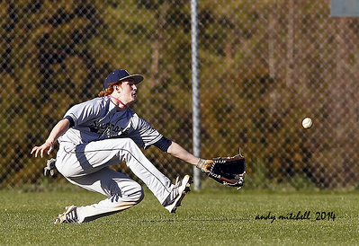 A Sycamore high school baseball player makes a sliding catch for an out.