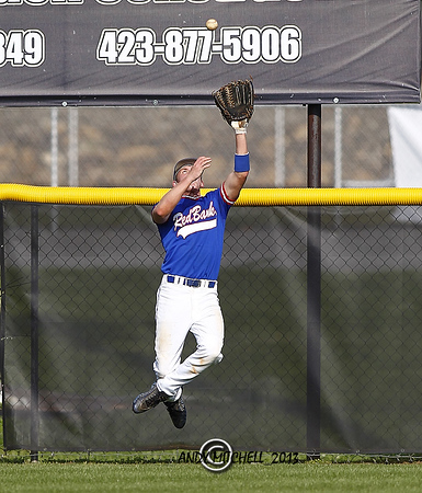 A Red Bank High School outfielder leaps to make a catch for an out during the TSSAA playoffs