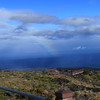 Rainbow over ocean at overlook in hawaii