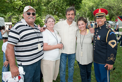 Joe Mantegna, actor from the CBS Show Criminal Minds, meets with fMrs. Giuliano and US Army Master Sergeant Antonio Giuliano who sang the National Anthem at the annual Rolling Thunder event at the Vietnam Memorial in Washington, D.C. during Memorial Day weekend on May 25, 2012
