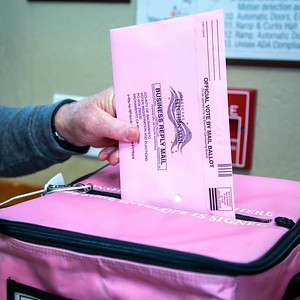 A Sacramento County voter deposits his mail-in ballot at the Sierra 2 Vote Center in Curtis Park on March 3, 2020. (Photo by Joan Cusick)