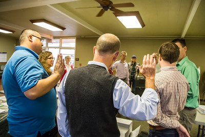 Before the doors open, the election inspectors administer an oath to the nine people who will work the polls. Poll workers receive $125 for their long day's service.