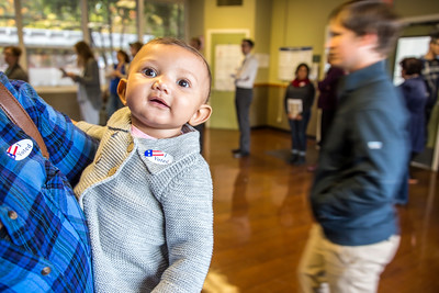 """Kate Cook brought her 7-month-old daughter Brooklyn Charles, who collected her first """"I Voted"""" sticker."""