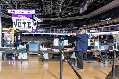 Voter Joel Acevedo of Sacramento picks up his paper ballot.