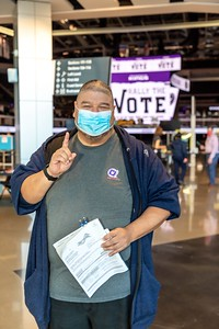 Voter Joel Acevedo was the first in line to vote at the Golden 1 Center.