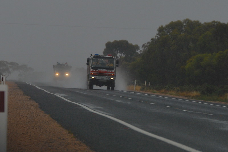 Interstate firefighters leave a wet State after fighting bushfires in over 40c