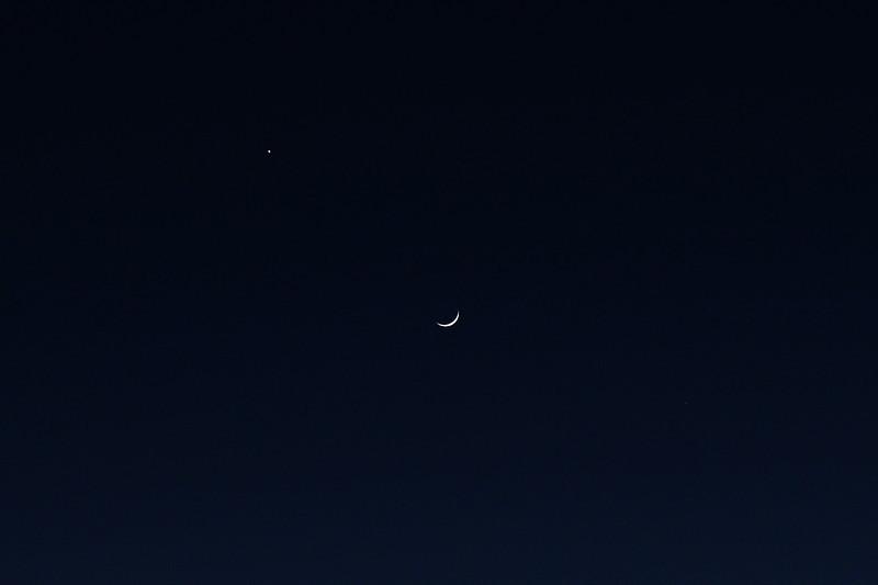 Moon brushes past Venus