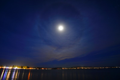 Halos around the sun or moon happen when high, thin cirrus clouds are drifting high above your head. Tiny ice crystals in Earth's atmosphere cause the halos. They do this by refracting and reflecting the light.