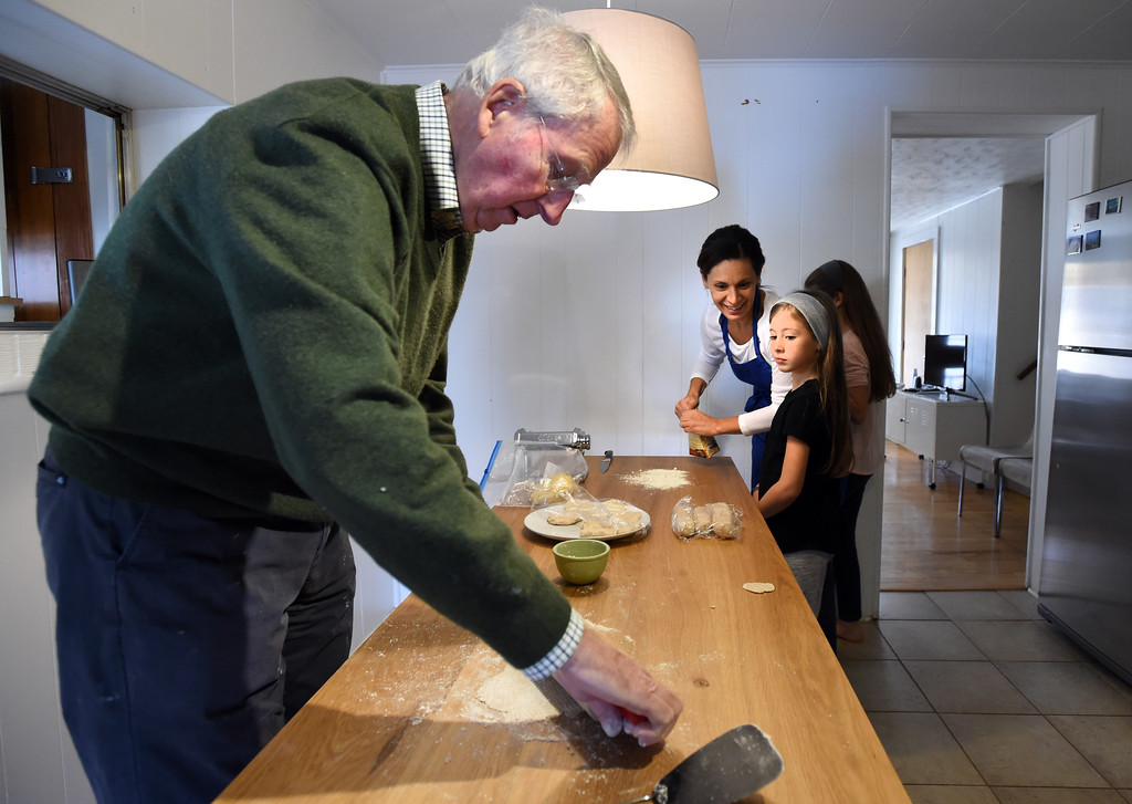 . Jim Steen makes the lufsa. Claudia Steen, her husband, Ted, father-in-law, Jim, and daughters, Sophia and Luce, were  making fresh Italian pasta and Norwegian lufsa (a soft potato bread) as part of their nontraditional Thanksgiving meal.  Cliff Grassmick  Photographer November 22, 2017