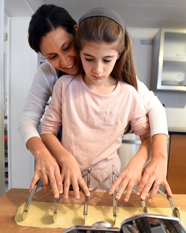 . Claudia Steen, and her daughter, Sophia, cut  the pasta dough. Claudia Steen, her husband, Ted, father-in-law, Jim, and daughters, Sophia and Luce, were  making fresh Italian pasta and Norwegian lufsa (a soft potato bread) as part of their nontraditional Thanksgiving meal.  Cliff Grassmick  Photographer November 22, 2017