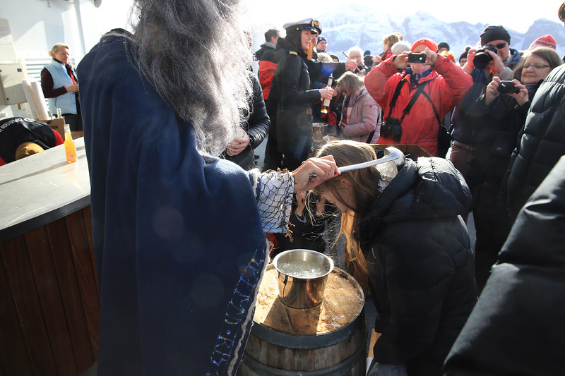 Celebrating the cross over of the Arctic Circle with ice and cold water down your back.