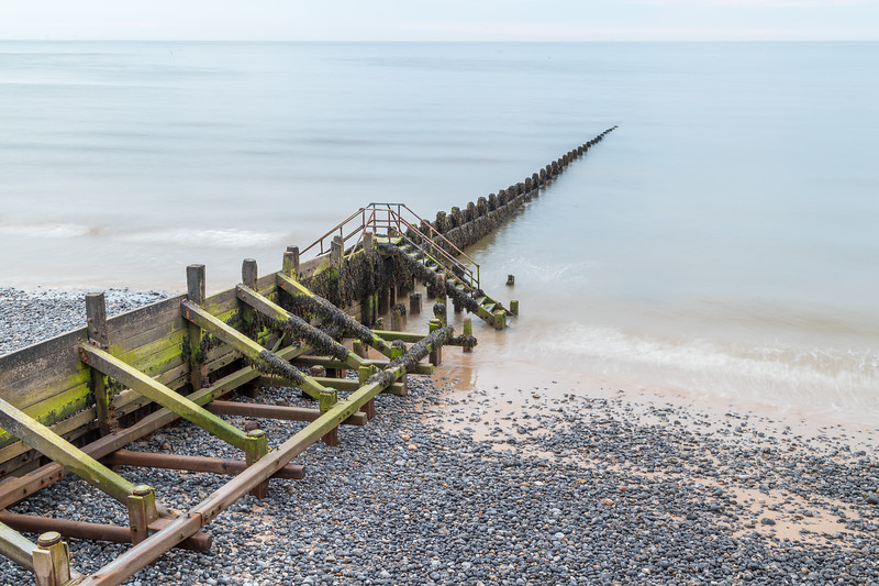 Wooden groyne stretching into the sea