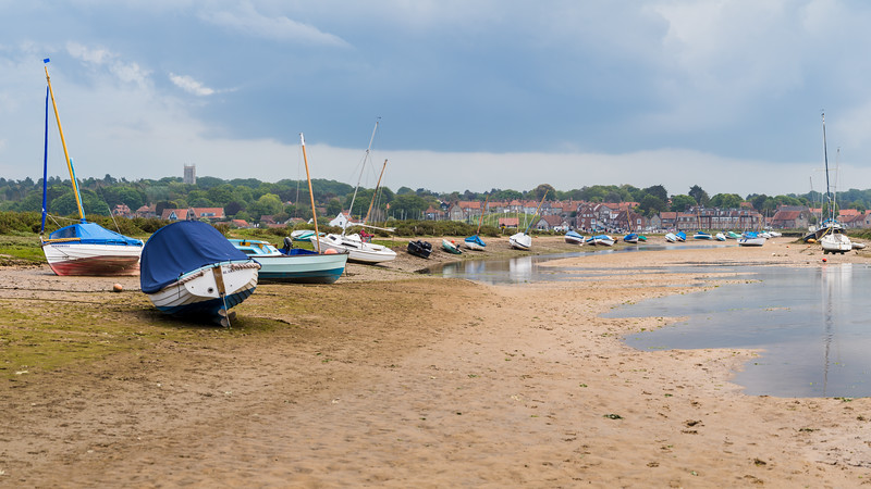 Boats at low tide by Blakeney Quay