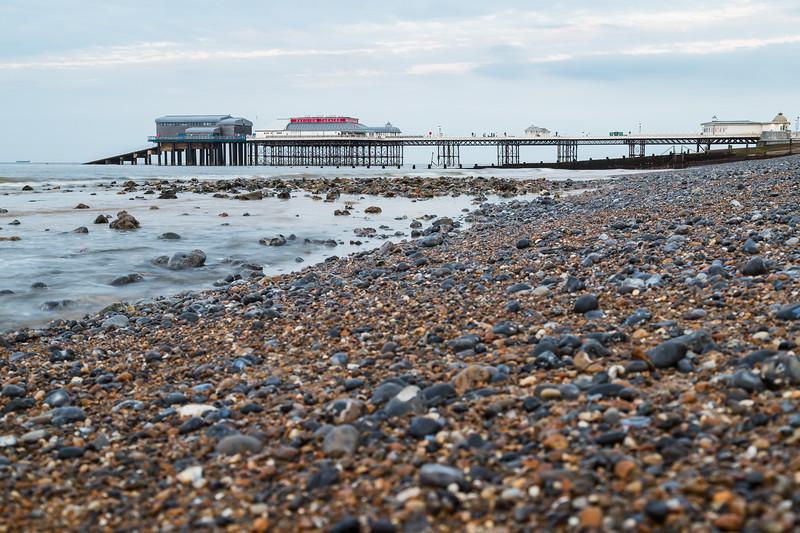 Cromer Pier seen over the shingle beach