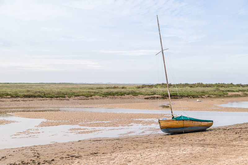 Sailing boat beached at low tide at Blakeney