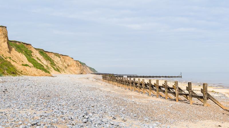 Pebbles and sea defences at West Runton beach