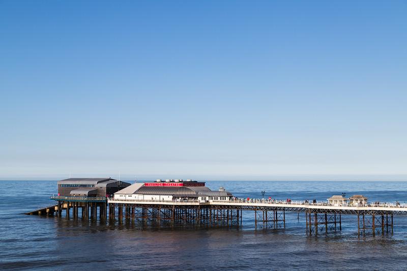 Cromer pier under a blue sky