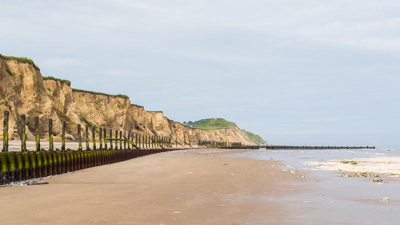 Sea defences at West Runton curve round the coast