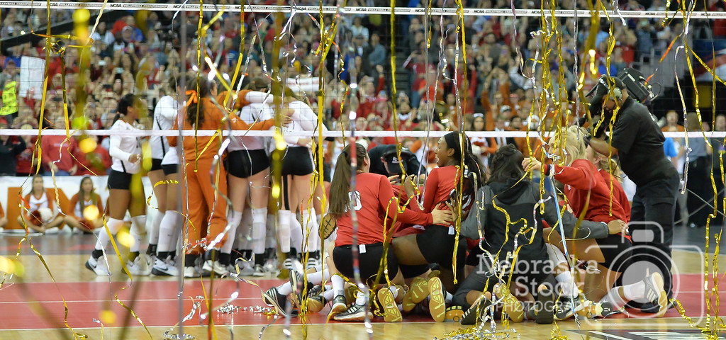 Photo by Aaron Beckman    The Lady Huskers celebrate their championship after they swept Texas in the NCAA Volleyball Tournament.