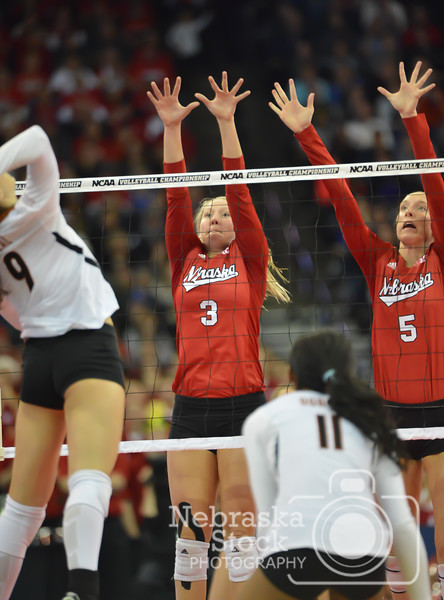 Photo by Aaron Beckman    Husker's Kelly Hunter(3) and Amber Rolfzen(5) go up to block a spike from Texas's Amy Neal Saturday night in Omaha.