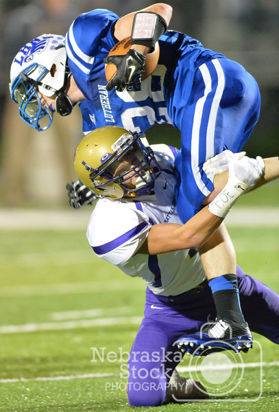 Brave's Jared Bellar tackles Eagle's Nate Stolze Friday night in Norfolk. Battle Creek went on to win against Lutheran High 35-0. Photo by Aaron Beckman