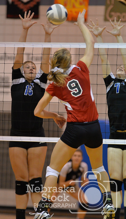 Lady Cardinal's Riley Sibbel attempts to spike a ball against Lutheran High's Gina Blackman (16) and Trystin Baker (7) Thursday night in Norfolk. O'Neill St. Marys went on to beat the Lady Eagles in 5 sets.  Aaron Beckman / Correspondent