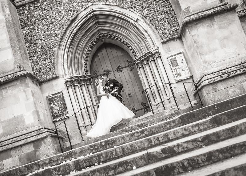 bride-groom-church-door-kiss-army-dress