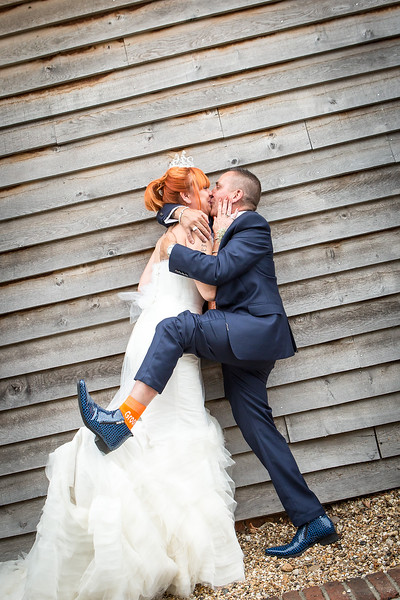 bride-groom-embrace-southend-barns-fun-quirky