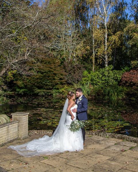 bride-groom-rivervale-barn-garden-lake