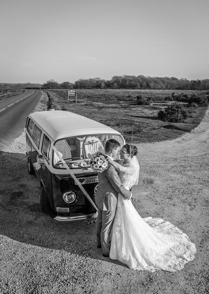 bride-groom-new-forest-vw-camper-embrace