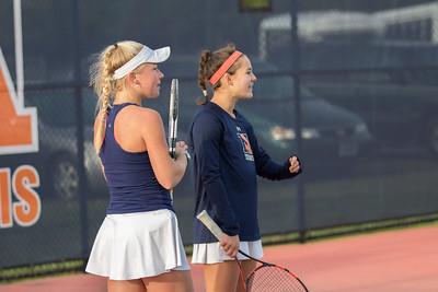 Caitie Sullivan and Jane Carter Chandler cheer on the #2 doubles between games
