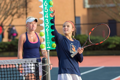 Jane Carter Chandler and Caitie Sullivan fix the scoreboard after going up 8-1 in the #1 doubles match