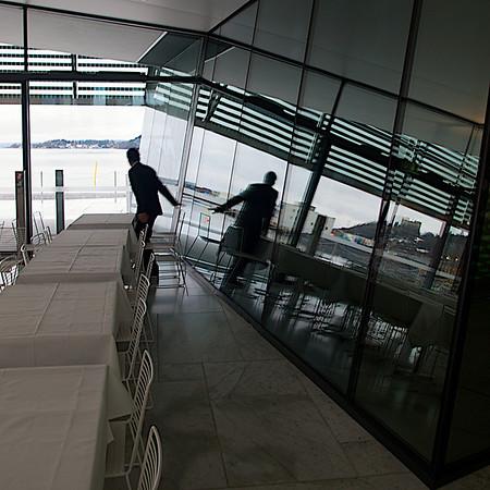 The Dancing Puppet. A Waiter prepares for guests. Oslo Opera House. Oslo. ********** Dansende marionett. En kelner gjør klar for gjester som ikke kommer. Operahuset i Oslo. Oslo. (Foto: Geir)