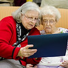 A celebration was held at Manor on the Hill on Tuesday afternoon to honor Norma Schofield, who turned 104 on September 12th. Jeanette Desjean, another resident, reads a proclmation given by Mayor Dean Mazzarella to Norma. SENTINEL & ENTERPRISE / Ashley Green