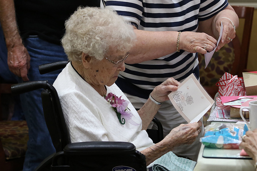 . Norma Schofield had her 106 birthday on Tuesday, September 12, 2018 at Manor On the Hill in Leominster where she now lives. Norma reads her birthday cards. SENTINEL & ENTERPRISE/JOHN LOVE