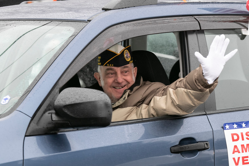 WWII veteran Petty Officer 2nd Class Norman (Cookie) Melanson turned 95 and on Saturday morning a parade of cars passed by his home in Leominster to wish him a happy birthday. Leading the parade of friends and family was some city fire and police cars. Veteran Larry McNeill waves to Melanson from his car as he passed by. SENTINEL & ENTERPRISE/JOHN LOVE