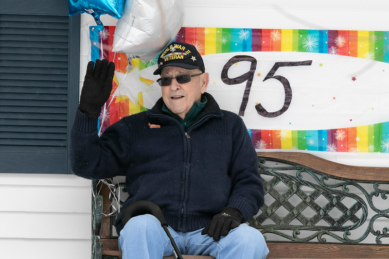 WWII veteran Petty Officer 2nd Class Norman (Cookie) Melanson turned 95 and on Saturday morning a parade of cars passed by his home in Leominster to wish him a happy birthday. Leading the parade of friends and family was some city fire and police cars. Melanson waves to the parade from his front porch. SENTINEL & ENTERPRISE/JOHN LOVE