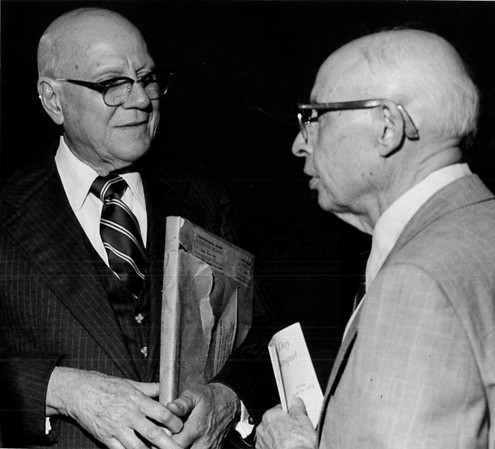 Harold Belknap, left, editor and publisher of the Norman Transcript, expressed gratitude to his former teacher and mentor, Dr. H. H. Herbert when the two attend OU's Journalism Banquet Friday, Apr. 18, 1976.