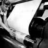 Archie Soloman putting a plate in press cylinder.