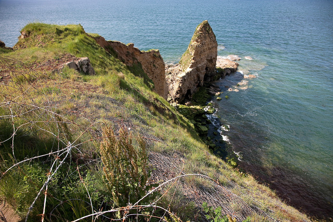 These are the cliffs of Pointe du Hoc. Imagine scaling them in the face of German machine guns. It doesn't seem possible.
